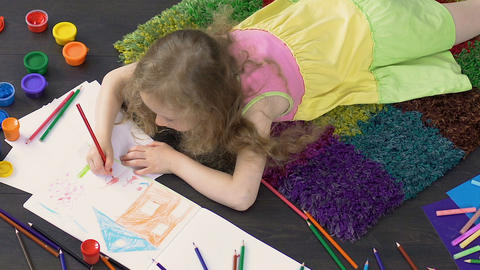 Little creative girl working on colorful pencil drawing, young talented artist Footage