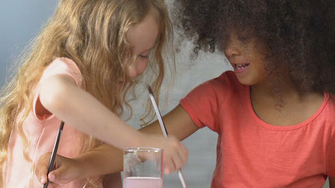 Happy little girls paint in one album with bright colors, childhood friendship Footage