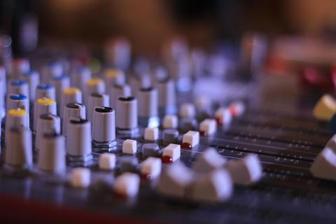 DJ music mixer control panel in macro フォト