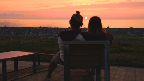 Peaceful couple enjoying sunset, romantic date, summer trip to Georgian resort Live Action