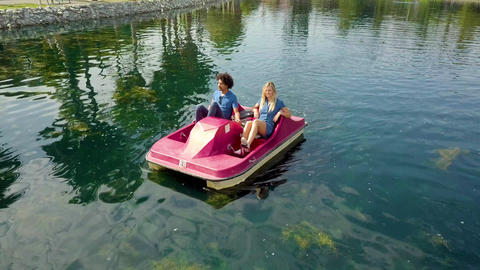 Cute Couple Enjoying A Boat Ride In The Park Footage