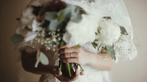 Bride's hands are holding a wedding bouquet. Bridal…, Live Action