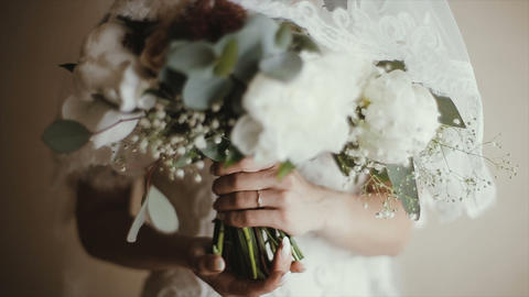 Bride's hands are holding a wedding bouquet. Bridal bouquet on wedding day Footage