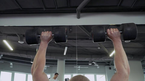 Two sports guys in the gym Live Action