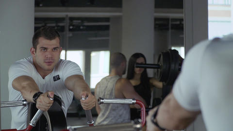 Handsome guy is engaged in the gym Footage