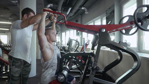 Two young guys in the gym Footage