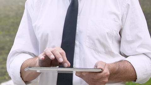 Busy man working on tablet, planning business day in mobile application, gadgets Live Action