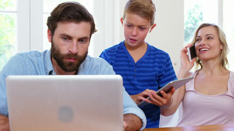 Cute family using electronic device Footage