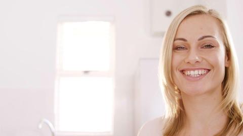 Portrait of a blonde woman smiling Live Action