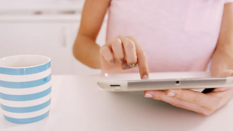 Woman using tablet on a table Live Action