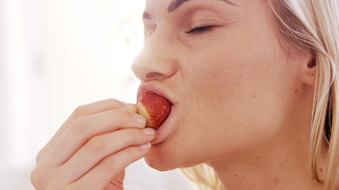 Close up on a woman eating a strawberry Stock Video Footage