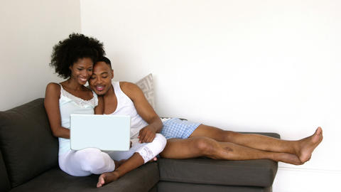Couple using a laptop Stock Video Footage
