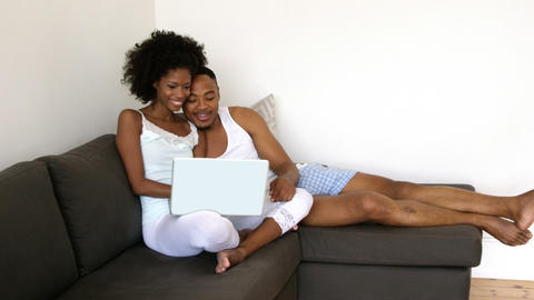 Couple using a laptop Live Action