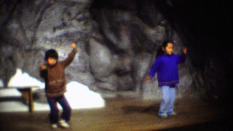 1974: Inuit tribal kids dancing traditional native style performance Footage