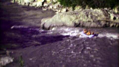 1974: Wild whitewater rafters brave dangerous wilderness rapids Footage