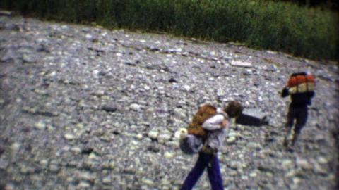 1974: Teenage backpack hikers camping in the wilderness bush Footage