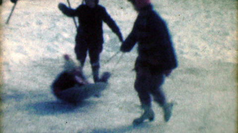 1957: Kids ice skating swing boy on winter snow sled playtimes Footage