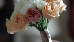 Bridal bouquet made of colorful roses in hand is held by groom 87 Footage