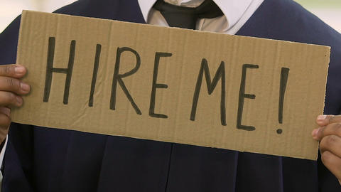 Male student holding hire me sign, future career expectations, opportunities Live Action