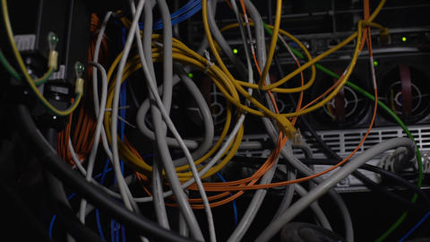 Tangled wires, power cables in datacenter, cleaning up server room cabling mess Footage