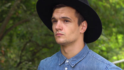 Portrait of young hipster man in hat Live Action