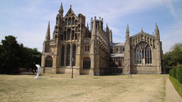 Ely Cathedral Ely Cambridgeshire UK on a hot summers day with dry grass GIF