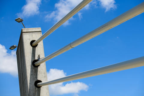 Detail of a concrete pillar with cables on cable, suspension bridge フォト