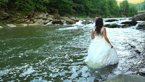 Slow motion. Happy couple in love have a joy during walk near river. 100fps Footage