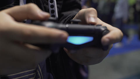 Boy playing virtual games with console, using joystick, youth entertainment Live Action