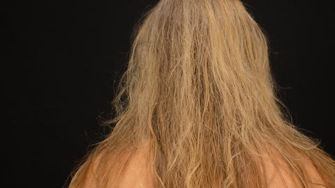 Blonde Woman Combs Her Hair From The Back Stock Video Footage