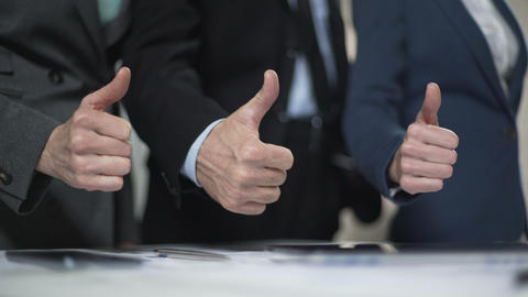 Coworkers showing thumbs up, campaign office promise candidate election victory Footage