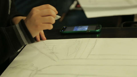 Art school student making sketch with pencil, class assignment, drawing circle Live Action