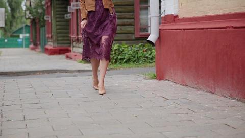 Sexy girl walks along the pavement on stiletto heels Footage