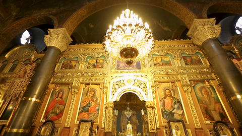 SOFIA, BULGARIA - CIRCA SEPTEMBER 2014: Religious art. Golden iconostasis with Live Action