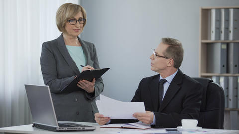 Satisfied male boss happy with correct report by woman... Stock Video Footage
