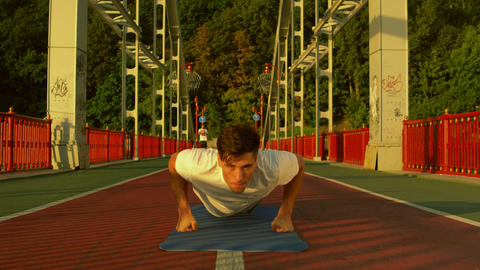 front view of a man doing push-ups GIF