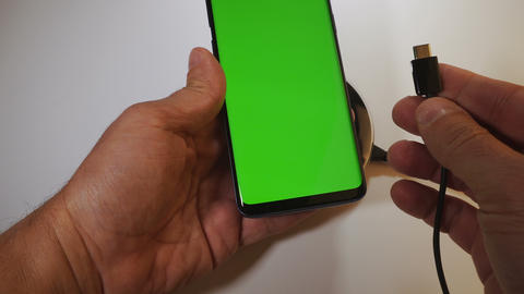 Wired vs wireless mobile phone charging with green screen locked & unlocked Live Action