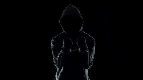 Silhouette of handcuffed male in hoodie, dangerous criminal punished by law Footage