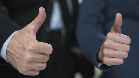 Thumbs up of business partners on successful project, successful investment Footage