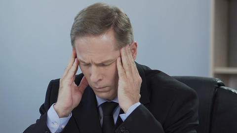 Businessman suffers from sick headache, problem at work,…, Live Action