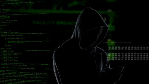 Faceless unrecognizable hooded hacker using smartphone to steal data, cybercrime Live Action