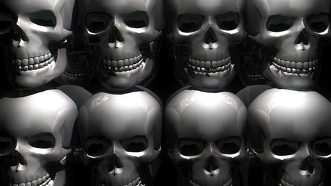 Rotating Silver Metallic Horror Helloween Skulls Shake Motion Black Background Footage