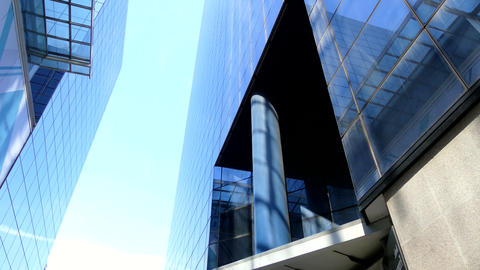 Business Man Walks Next to Glass Buildings Footage