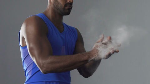 Hispanic athlete taking talcum powder, full of victory confidence, sport career Live Action