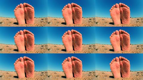 Feet legs strewn sprinkled sand sanded on sandy beach ckose-up Live Action