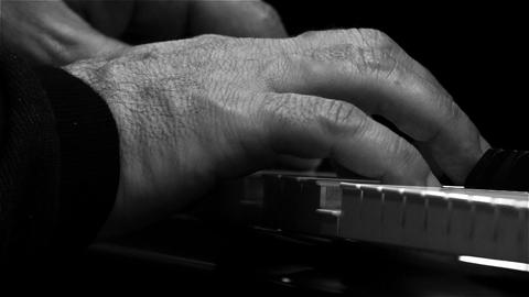 Musician Playing The Piano. Close-Up. Black And White Tone Live Action