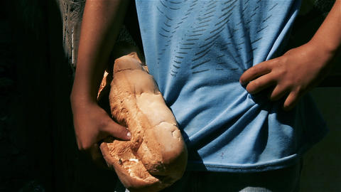 Boy Holding A Huge Bread Live Action