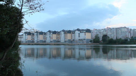 Multistory modern house on lake bank. Block house near river in evening Live Action