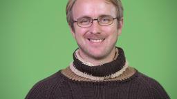 Happy handsome man wearing turtleneck sweater and eyeglasses Footage