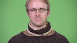 Blonde handsome man wearing turtleneck sweater and eyeglasses Footage